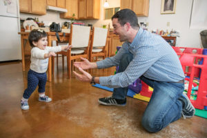 Habitat homeowner watches daughter's first steps