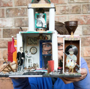 Artist Lisa Freeman with one of her assemblage pieces