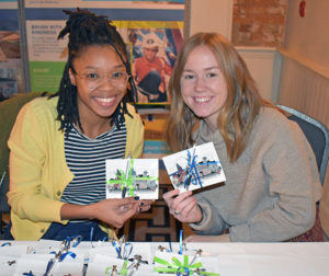 Interns Indigo Harris and Katie Quinn staff the reception table at the 2019 gala