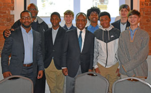 Michael Thurmond with members and coaches of the Clarke Middle School Owls boys' basketball team