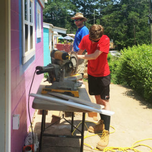 AAHFH volunteers sawing at build site
