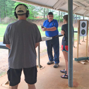 Mike Wasielewski demonstrates firearm safety procedures at the pistol range of the South River Gun Club