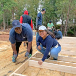 Future homeowner Fay Hill works with Habitat crew and volunteers on a Kinda Tiny Home