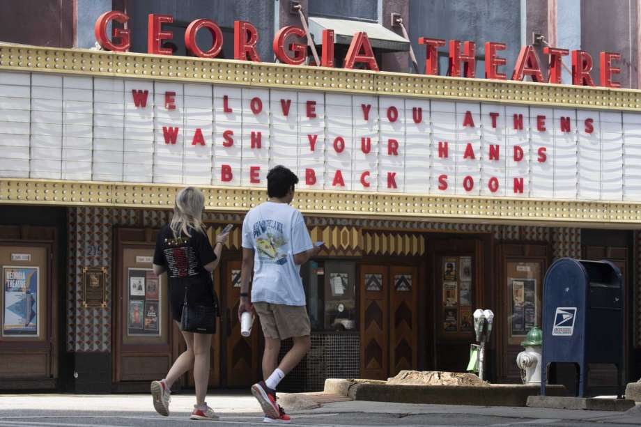 Georgia Theatre marquee: We love you. Wash your hands. Be back soon.
