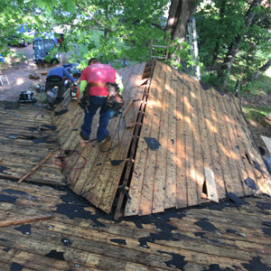 Roofers from Accent Roofing make repairs on a home in Athens, GA